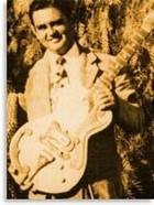 На фото Мэрл Трэвис с гитарой Bigsby